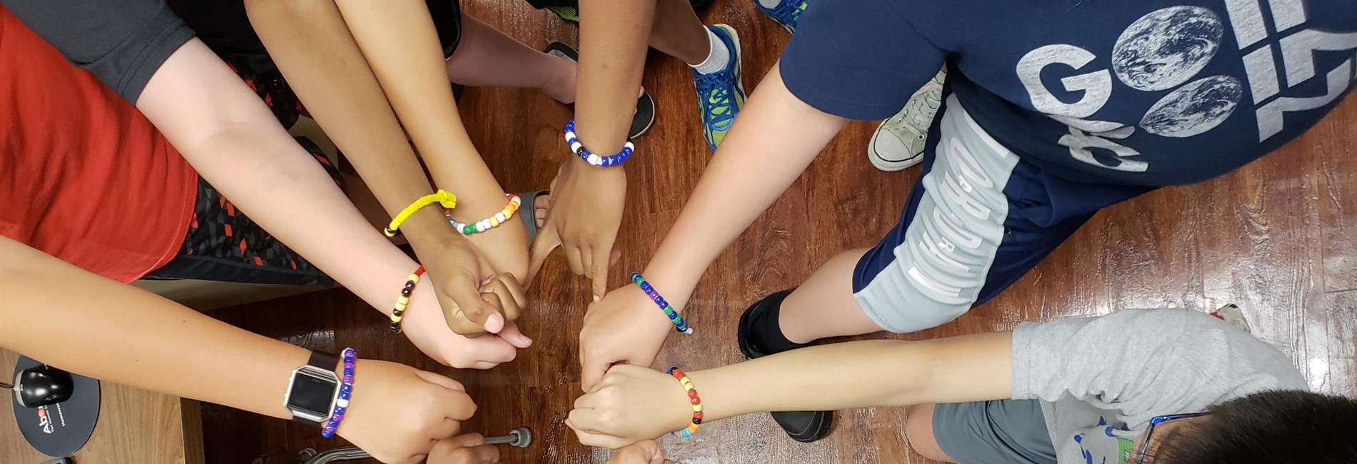 Summer Snowflakes Coding students show off their binary bracelets